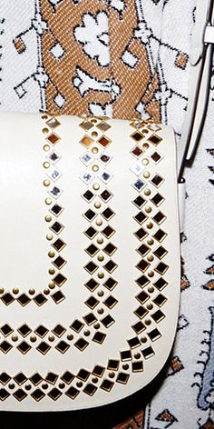 Details, details: a saddlebag embellished with more than 200 hand-applied mirror studs #toryburch #toryburchfall15  #nyfw