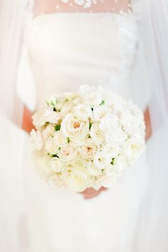 Round ivory bouquet with hints of peach #weddingbouquet #bouquet