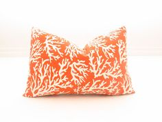 beautiful coral pattern orange/white pillow.  [great etsy shop for affordable pillows]