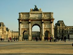 """There's more than one """"Arc de Triomphe."""" Many tourists accidentally wander past l'Arc du Carrousel that flanks the Louvre's main courtyard. Completed in 1808, it was also commissioned by Napoleon to commemorate his army's military prowess. Louis XIV, who built Versailles, also constructed two of his own: Porte Saint-Denis and Porte Saint-Martin. Their imagery illustrate """"Louis le Grand's"""" military victories against the Spanish."""