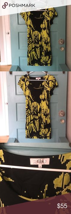 Black and green Tibi dress This fun little dress can be worn multiple ways! Wear it with some heels in the summer or with leggings and boots in the winter. Tibi Dresses Mini