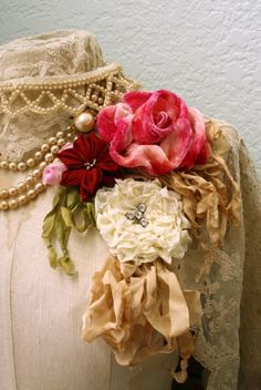 Love these frou frou fabric flowers, beads, lace and old fashioned.  So shabby and elegant.