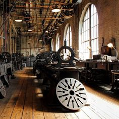 old machine shop with overhead belts and wood floor