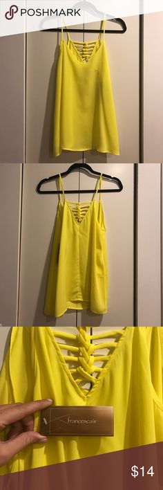 Tank top wth strappy back Yellow tank top with strappy back. Perfect for vacation or summertime! Francesca's Collections Tops Tank Tops