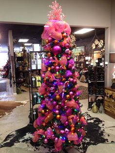 Christmas tree In fuchsia and orange at One Posh Place in Grapevine TX. Myposhplace.com