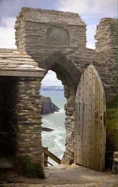 Medieval Tintagel Castle ruins ~ birthplace of King Arthur with rugged,clifftop backdrop, Cornwall, England. I love the door and the old world look it has. I can only imagine how this castle looked in the middle ages or before when it was in use. Oh The Places You'll Go, Places To Travel, Places To Visit, Beautiful World, Beautiful Places, Beautiful Pictures, Castle Ruins, Medieval Castle, Abandoned Places