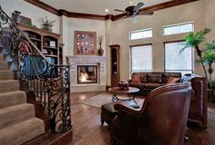 Traditional Family Room with leather furniture and hard wood floors