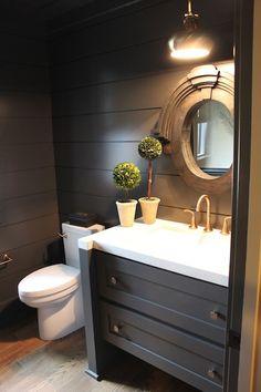 Powder room: vanity cabinet, wall paneling, dark grey, port hole mirror