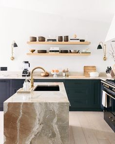 This photo of @annariflebond's kitchen makes us believe in the beauty of some great open shelving (as if we didn't already!). What meals would you most like to prepare in this gorgeous kitchen? If you ask us, that island countertop is just begging to be filled with cupcakes and donuts... #theeverygirlathome || photo by @juliarobbs via @cupofjo