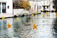 Sparkling star decorations on Sile river during winter holidays in Treviso city, in Veneto, Italy. Holiday City, Sparkling Stars, Star Decorations, Winter Holidays, Sparkle, Italy, River, Stock Photos, History