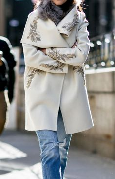 Eggshell white winter coat with brocade detail | See All the Best NYFW Street Style this Fall 2016 @stylecaster