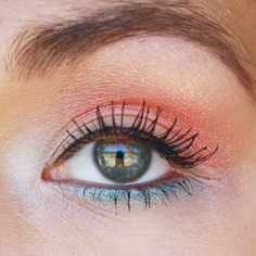 Coral pink and blue eye makeup