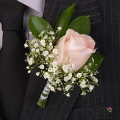 matching light pink rose and baby's breath.