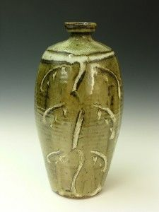 A tall bottle with Nuka glaze over an iron slip with incised decoration through the slip.  Phil Rogers