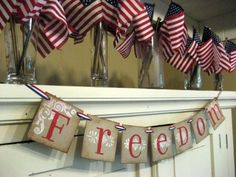 For the 4th of July; 4x4 inch chipboard card hand-stamped in acrylic paint with a white background flourish and red letter, then antiqued for a worn-leather, vintage appeal. Strung on over 40 inches of red, white and blue patriotic ribbon, FREEDOM can be adjusted to fit your unique space.