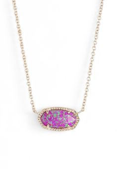 This fuchsia and gold pendant necklace is the perfect accessory to add a pop of color to the fall wardrobe.