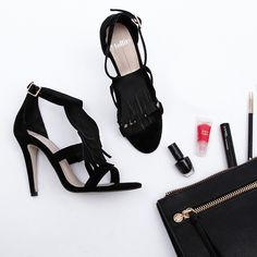 Party in style! This fringe heel by Mollini speaks glam. Pair these black beauties with a black or white dress and let the heels steal the show. SHOP > http://www.styletread.com.au/heedy-black.html | Mollini | Heels | Party Heels | Flat Lay | Styletread | Style | Glam | NYE