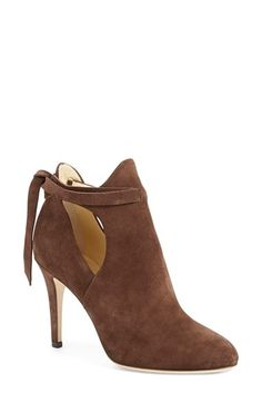 Free shipping and returns on Jimmy Choo 'Marina' Tie Strap Bootie (Women) at Nordstrom.com. Buttery-soft suede in a rich cinnamon hue styles these sleek almond-toe booties designed with a curvy topline and side cutouts. Laces that crisscross and tie at the back add a chic, custom detail to the look.