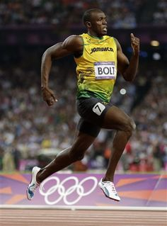 AMAZING PIC!!!!! Jamaica's Usain Bolt races to his gold medal finish in the men's 200-meter final during the athletics in the Olympic Stadium at the 2012 Summer Olympics, London, Thursday, Aug. 9, 2012. (AP Photo/Gregory Bull)