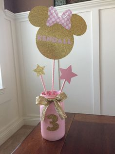 Minnie Mouse Name Center Piece. Pink and gold minnie mouse party. Mason Jar listed in another add by BlueSpringsBoutique on Etsy https://www.etsy.com/listing/496399907/minnie-mouse-name-center-piece-pink-and