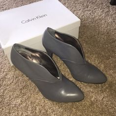 Calvin Klein Jazz Kid Skin Graphite Casual Heels New in box, never worn. Heels 4in high. ✨Save $$$ when bundling with other items. NO TRADE Calvin Klein Shoes Heeled Boots