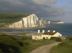 Coastguard Cottages at Seaford Head, with a view along the Seven Sisters