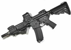Short Barreled AR15 SBR. Equipped with VLTOR Imod stock, Magpul grip, BAD lever, ASAP, AFG, and MBUS. Noveske receiver, Aimpoint Micro, and Battle Comp compensator device. This is one slick little M4 package.
