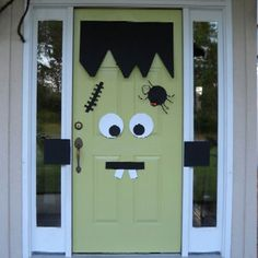 Halloween curb appeal - Frankenstein door.  Cute and not so scary.  Although the spider might be too much. LOL