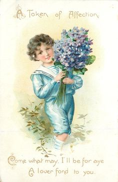 boy in blue outfit carries purple violets