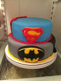 Superhero cake; the Superman top cake is vanilla white cake with raspberry mousse. Bottom Batman cake is chocolate cake with salted caramel mousse. All decorations are made of fondant.
