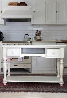 DIY kitchen island (table turned into island) - sofa table turned into an island by adding feet and a new top.