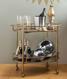 "Perfect for  holiday entertaining: The oval shape of this 34.5""Wx17.88""Dx30.13""H bar cart is eye-catching and provides plenty of usable deck space to boot. About $289; Wayfair"