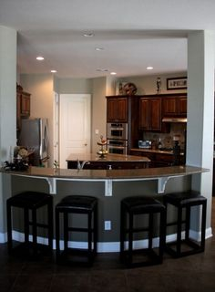 """I'm not a big fan of the noise from an """"open"""" concept kitchen/family room. This is a perfect solution. Again, love the curve."""