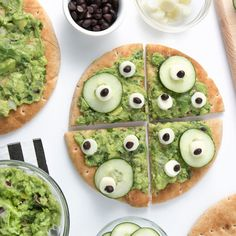 """Monster Pita Pizza - This no-bake pizza is so easy to make, and it's even more fun to eat! Kids will love the spooky """"monster eyes"""" made from cucumbers, cheese and beans for this cute Halloween snack. Entree Halloween, Halloween Appetizers, Halloween Food For Party, Halloween Halloween, Halloween Buffet, Halloween Images, Easy Healthy Dinners, Healthy Chicken Recipes, Healthy Foods To Eat"""