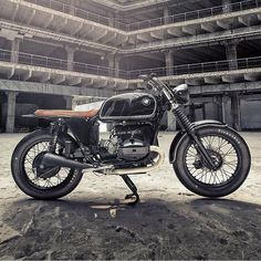 @soulmotorco's BMW R100 custom taking a fiver at the concrete schoolyard.  @mikepazphoto #builtnotbought #vintagemotorcycle #dropmoto #bmw #r100 #streettracker #tracker by dropmoto