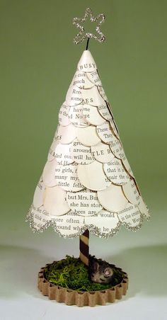 Hutch Studio: Under The Tree. A cute mini Christmas tree made from repurposed book pages. Could also paint, embellish with sequins and glitter, etc.