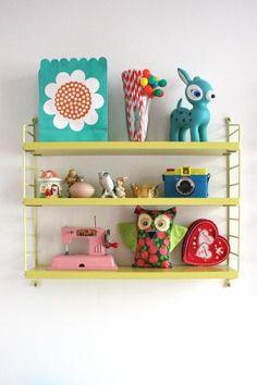 Love the yellow shelf