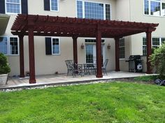 Cedar Artisan Pergola with cedar-wrapped posts and mahogany stain http://www.backyardunlimited.com/pergolas