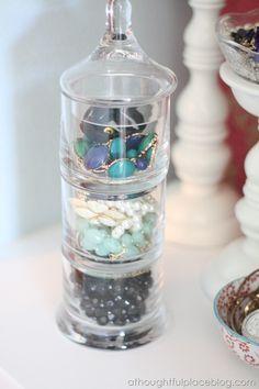 Stackable glass jar for jewelry storage.