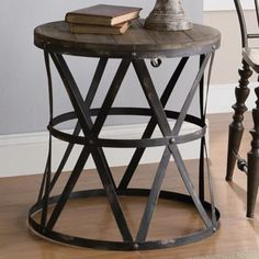 Casual wood-top round accent table features an industrial metal webbed base $223.91