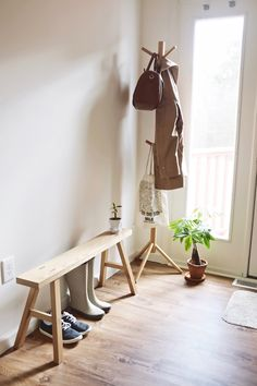 Muji's natural beech coat tree is perfect for any entryway. We always try to keep reusable bags on of the bottom hangers to remind us to bring them to the store for quick shopping trips.
