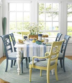 fresh and clean looking breakfast table. I like the idea of colored chairs, and having the head of table another color.