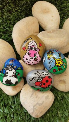 Painted magnet pebbles with a funny drawing written by RockByVicki