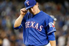 Texas Rangers starting pitcher Derek Holland (45) exits the game as he is relieved in the third inning against the Toronto Blue Jays at Rogers Centre on May 5, 2016. Mandatory Credit: Kevin Sousa-USA TODAY Sports ORG XMIT: USATSI-259100