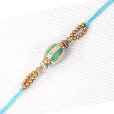 View this rakhi at http://rakhi.giftstoindia24x7.com/Gifts/Rakhi/Rakhis/Rakhi_for_Brother/Exclusive_Rakhi/vibrant-green-golden-bead-rakhi.aspx