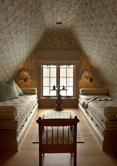 Cosy attic bedroom with upholstered walls and ceiling, sconces, daybeds - Barry Dixon