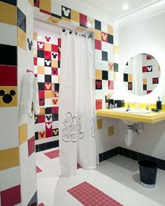 Kids' Bathroom Decorating Ideas: The colorful tiles on the wall give great look.