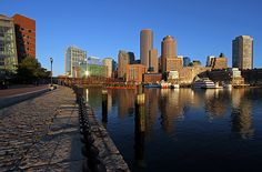 Boston skyline photography from New England based award winning fine art photographer Juergen Roth showing landmarks such as Boston Downtown, Boston Harbor, Financial District, US Coast Guard, National Oceanic and Atmospheric Administration, Rowes Wharf, One International Place, Fan Pier, Odyssey cruise ship and the Boston harbor hotel as seen from the Boston Harbor walk at Fan Pier.   Good light and happy photo making!   My best,   Juergen  www.rothgalleries.com