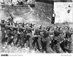 Fransız direniş hareketinden Georges Blind, kendisini infaz edecek Alman askerlere karşı gülümserken, 1944