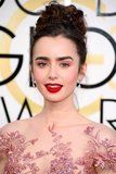 Beauty :: Lily Collin's just walked the 2017 Golden Globes red carpet looking like a Pinterest dream. First, her makeup caught our eye. Lily showed off her flawless porcelain skin with dusty rose pink eye shadow, a nod to her gorgeous gown. We already know pink eye was a top trend of 2016, and it looks like celebrities are keeping it going this year, as well. A matte brick-red lip and her signature bold brows were the bookends to this dreamy look. Now, let's talk about her hair. She rocked a…